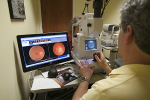 Dr. Elliot Waterman, O.D., Doing a Retina Exam with Advanced Imaging Equipment
